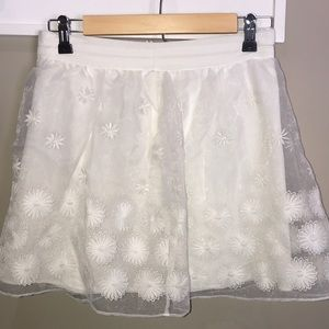White lace-embellished skirt